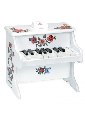 White piano with scores
